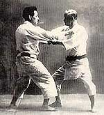 Jigoro Kano (right) practicing Judo with Kyuzo Mifune, 10th dan