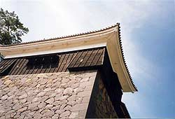 A close up shows the ishiotoshi (openings through which stones could be dropped on adversaries).