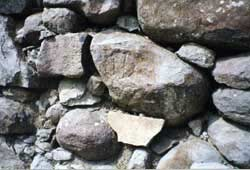 A donor's mark can be seen on one of the wall stones.